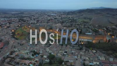 Carcassonne Old City Illuminated At Dusk Seen By Drone