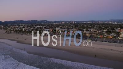 Los Angeles Aerial Flying Los Angeles California Over Venice Beach Panning At Dusk - Video Drone Footage