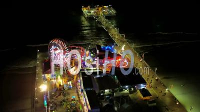 Los Angeles Aerial Flying Los Angeles California Over Santa Monica Peer At Night Panning Down - Video Drone Footage