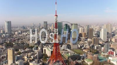 Japan Tokyo Aerial  Flying Low Backwards Away From Tokyo Tower With Cityscape Views - Drone Point Of View