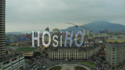 Lima Peru Flying Over Park Plaza And Traffic Panning With Cityscape Views. - Video Drone Footage
