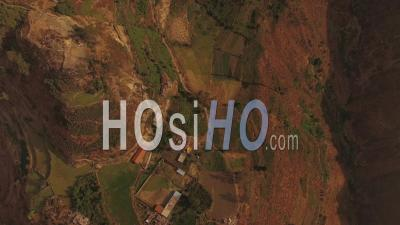 Peru Flying Over Mountain Hillsides Looking Down - Video Drone Footage