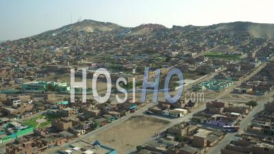 Ventanilla Peru Flying Low Over Urban Poverty Hillside Housing Area. - Video Drone Footage