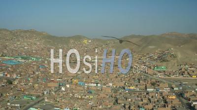 Ventanilla Peru Flying Low Over Urban Poverty Hillside Housing Area Panning In Mi Peru. - Video Drone Footage