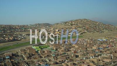 Ventanilla Peru Flying Low Over Urban Poverty Hillside Housing Area In Mi Peru. - Video Drone Footage