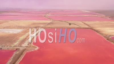 Aerial View Over Bright Red And Pink Salt Pan Farms Near Walvis Bay, Namibia - Video Drone Footage