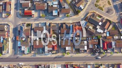 Straight Down High Aerial View Contrasting Neighborhoods Above Ramshackle Township Of Gugulethu, One Of The Poverty Stricken Slums, Ghetto, Or Townships Of South Africa - Video Drone Footage