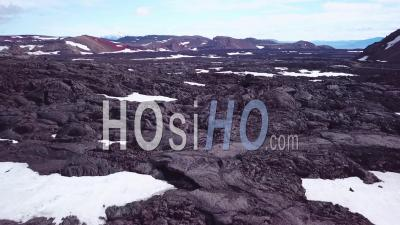 Aerial View Over Vast Lava Fields And Snow Near Askja Iceland - Video Drone Footage