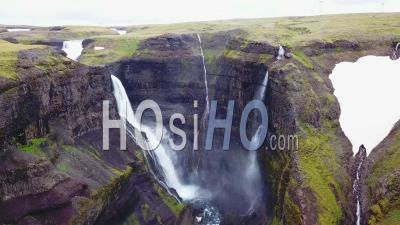Aerial View Over The Beautiful And Amazing High Waterfall Of Haifoss In Iceland - Video Drone Footage
