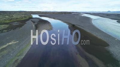 Aerial View Of The Outwash Pattern And Flow Of A Glacial River In A Remote Highland Region Of Iceland - Video Drone Footage
