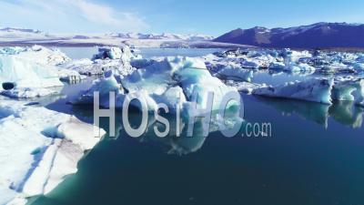 Aerial View Over Icebergs In The Arctic, Jokulsarlon, Glacier Lagoon In Iceland - Drone Point Of View