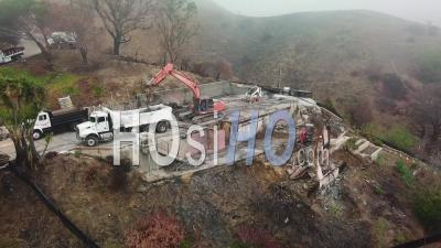 Aerial View Of A House Being Bulldozed On A Hillside In Ventura Following The Destruction Of Thomas Fire - Video Drone Footage