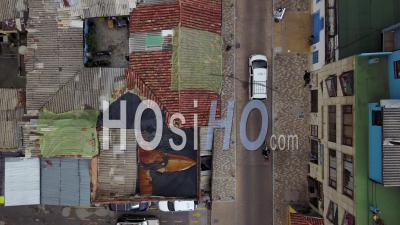 Aerial View Looking Straight Down Of A Red Tile Roofed Neighborhood And Streets In Bogota, Colombia - Video Drone Footage