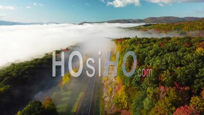 Aerial View Over A Highway Through The Fog In Fall In New England - Video Drone Footage