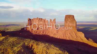 Aerial View At Sunset Over Rock Formations In Monument Valley, Utah - Drone Point Of View