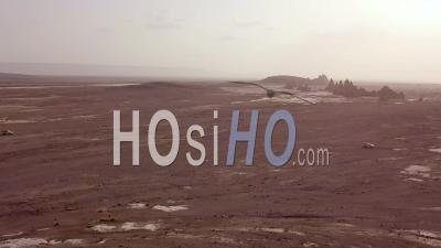 Aerial View Over Two 4 Wd Jeeps Driving Across A Wild And Rugged Landscape In Djibouti Or Somalia - Video Drone Footage