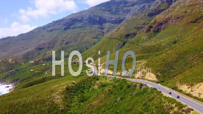 Aerial View Of Two Motorcycles Traveling On The Beautiful Coastline And Narrow Roads South Of Cape Town, South Africa - Video Drone Footage