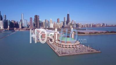 Daytime Aerial View Around Navy Pier In Chicago With The City Skyline Background - Video Drone Footage