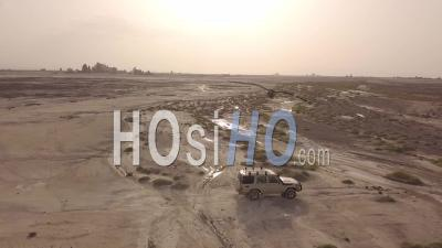 Aerial View Over Two 4x4 Jeeps Traveling Across The Deserts Of Djibouti Or Somalia - Video Drone Footage