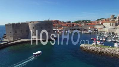 Aerial View Over The Harbor At The Old City Of Dubrovnik, Croatia - Video Drone Footage