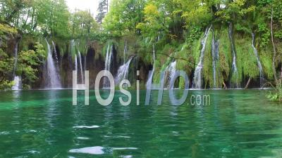 Beautiful Waterfalls Flow Through Lush Green Jungle At Plitvice National Park In Croatia - Video Drone Footage