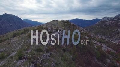 Aerial View Over The Mountains Of Montenegro Reveals Beautiful Boka Bay - Video Drone Footage