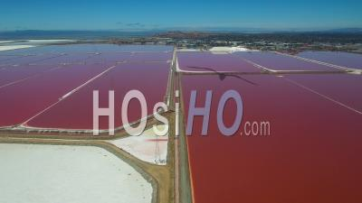 Aerial View Over The Red And White Salt Flats In The Fremont, California Bay Area - Video Drone Footage