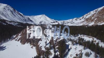 Aerial View Over A Remote Abandoned Cabin On A Mountaintop In The High Sierra Nevada Mountains In Winter - Video Drone Footage
