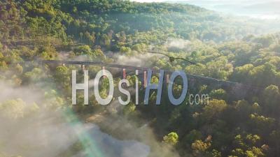 Aerial View Over A Steel Railway Trestle In The Fog In West Virginia Appalachian Mountains - Drone Point Of View