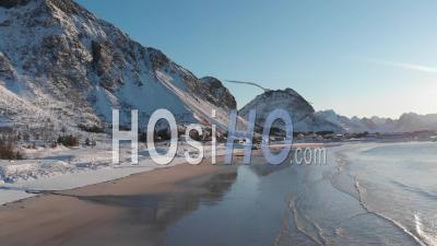 Snowy Beach On A Sunny Day In The Lofoten Islands - Video Drone Footage