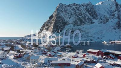 The Fishing Village Of Reine From Above, Covered By Snow - Video Drone Footage