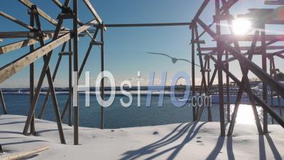 Stockfish Under The Snow In Reine, Lofoten Islands - Video Drone Footage