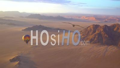 Hot Air Balloons Fly In The Namib Desert In Namibia - Video Drone Footage