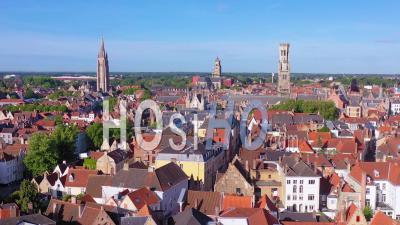 Aerial View Of The Skyline Of Bruges Belgium Includes Belfort Van Brugge And Other Landmarks - Video Drone Footage