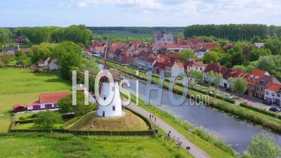 Aerial View Over Canal And Small Town Of Damme, Belgium And Historic Windmill - Video Drone Footage