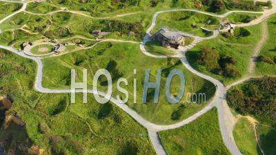Aerial View Over Pointe Du Hoc, Normandy, France D-Day Site Pockmarked With Bomb Craters - Drone Point Of View