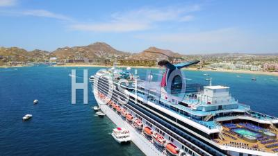 Huge Cruise Ship Aerial View Off Coast Cabo San Lucas, Baja California, Mexico Hotels And Resorts Along Coast - Video Drone Footage