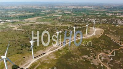 Wind Farm Producing Electricity On Top Of A Hill - Video Drone Footage