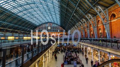The Interior Of St Pancras Station In London With Commuters At Rush Time