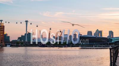 Cable Cars In The Dockland District In London At Sunset, Transition To Night (holy Grail)