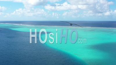 Aerial View Of A Coral Barrier In French Polynesia - Video Drone Footage