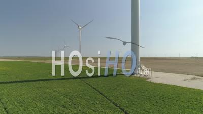 Rotating Wind Turbines And Wind Farm In Ile-De-France, Seine-Et-Marne, France, Video Drone Footage