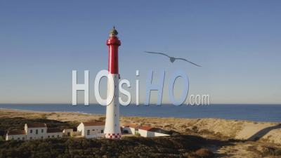 Low Level Turning Around La Coubre Lighthouse With Ocean Video Drone Footage
