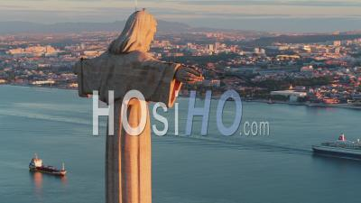Aerial View Of Lisbon, Christ The King And 25 De Abril Bridge, Portugal - Video Drone Footage