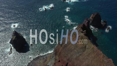 Rocks In The Ocean At Do Topo Lighthouse Point In San Jorge Azores - Video Drone Footage