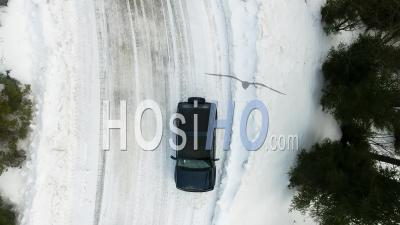 Off-Road Car Driving On A Mountain Snowy Road - Video Drone Footage