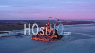 First Rays Of Sunlight On Mont Saint-Michel At Sunrise - Video Drone Footage