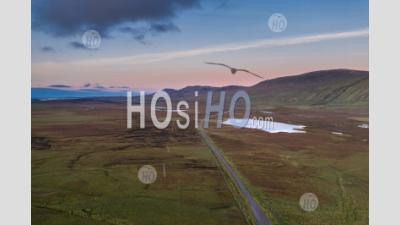 Aerial View Over A838 Across Scottish Highlands At Sunset - Aerial Photography