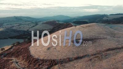 Rolling Hills Of British Countryside At Frosty Sunrise - Drone Point Of View