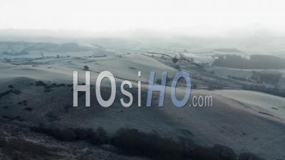 Frosty Hills Of British Countryside At Sunrise - Drone Point Of View